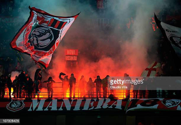 Supporters of AC Milan attend the Serie A match between Milan and Brescia at Stadio Giuseppe Meazza on December 4 2010 in Milan Italy