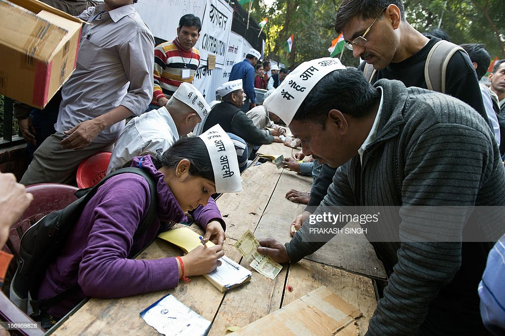 Supporters of activist turned politician Arvind Kejriwal line up to give donations during the launch of the 'Aam Aadmi Party' (Common man party) in New Delhi on November 26, 2012. The Aam Aadmi Party (AAP), India's newest political party, was formally launched by activist turned politician Arvind Kejriwal in the presence of thousands of supporters. AFP PHOTO/ Prakash SINGH