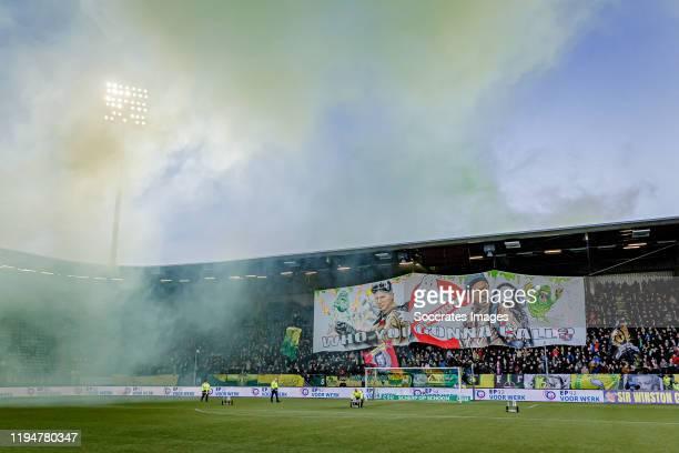 Supporters of ADO Den Haag banner coach Alan Pardew of ADO Den Haag, assistant trainer Chris Powell of ADO Den Haag during the Dutch Eredivisie match...