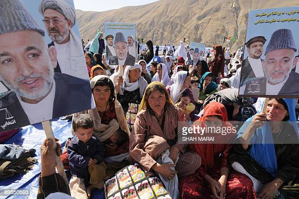 Supporters of Afghan President Hamid Karzai one of 41 presidential candidates attend a campaign rally addressed by Karzai in Kaihan valley in central...