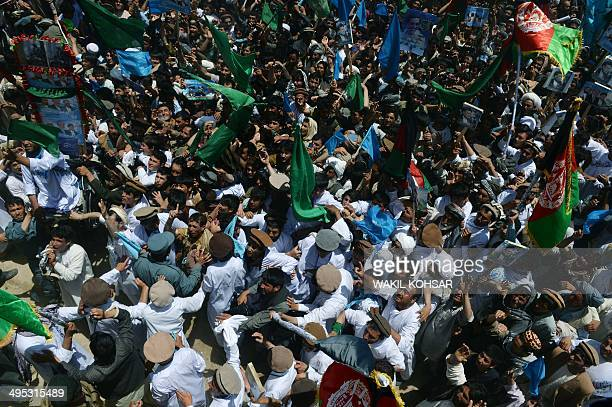 Supporters of Afghan presidential candidate Abdullah Abdullah gather during an election campaign rally in QalayiNaw city in the Badghis province of...