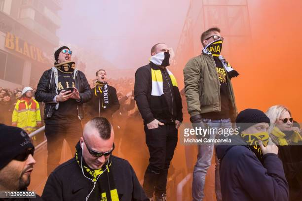 Supporters of AIK await for the arrival of the team bus before the start of the opening day Allsvenskan match between AIK and Ostersunds FK at...