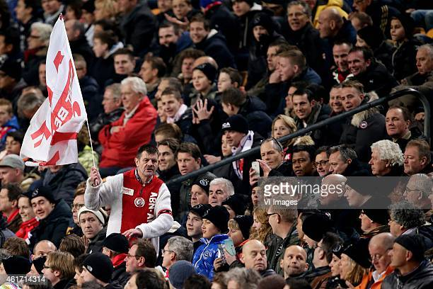 supporters of Ajax met vlag rennend door publiek during the Dutch Eredivisie match between Ajax Amsterdam and FC Groningen at the Amsterdam Arena on...