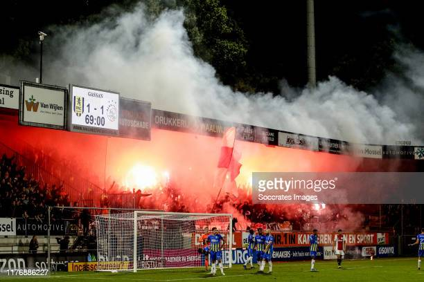 Supporters of Ajax with firework during the Dutch Eredivisie match between RKC Waalwijk v Ajax at the Mandemakers Stadium on October 19, 2019 in...