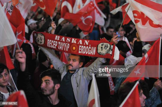 Supporters of AK party celebrate their referendum win at the party headquarters on April 16 2017 in Ankara Turkey Turkey's prime minister has...