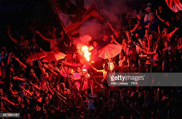 Supporters of Al Ahly SC let off flares during the FIFA Club World Cup 5th place match between Al Ahly SC and CF Monterrey at the Marrakech Stadium...