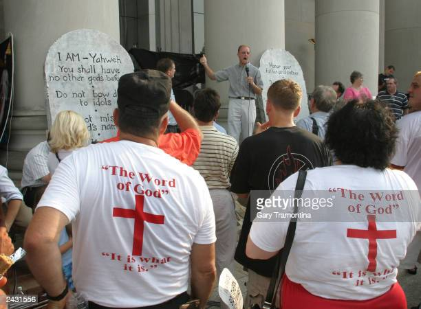 Supporters of Alabama Chief Justice Roy Moore rally outside the judicial building August 26 2003 in Montgomery Alabama A 5300pound sculpture of the...