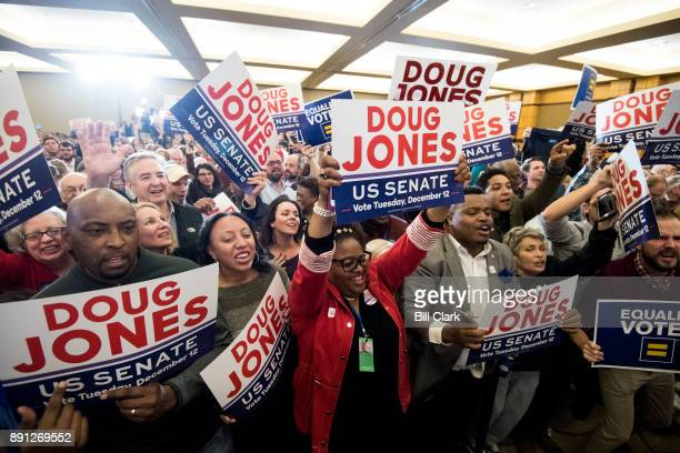Supporters of Alabama Democrat Doug Jones celebrate his victory over Judge Roy Moore at the Sheraton in Birmingham Ala on Tuesday Dec 12 2017 Jones...