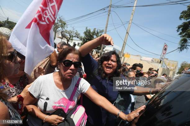 Supporters of Alan García and Aprista Party wave flags and sing political slogans related to Alan García at the emergency hospital Casimiro Ulloa...