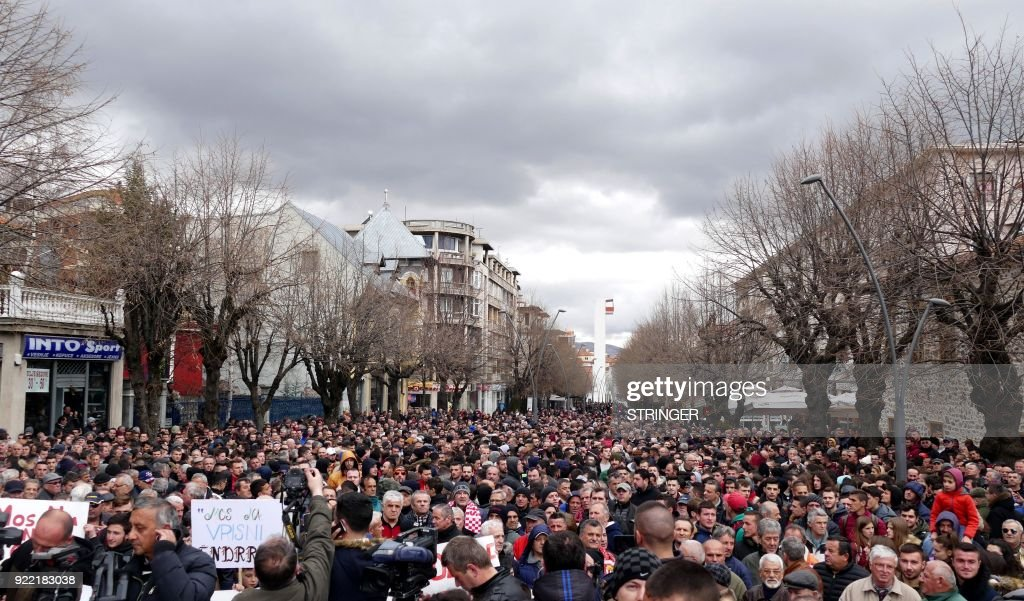 Supporters of Albanian football team Skenderbeu take part in a rally in support of their team in response to allegations of match-fixing, in the city of Korca on February 21, 2018. UEFA is conducting an investigation that could lead to a 10 year ban for the team from the Champion League and a one million Euro fine for alleged match-fixing. Football Club Skenderbeu, Albanias reigning champions, has been previously banned from UEFA competitions in the 2016/17 season for match-fixing. UEFA announced last week that its investigators, had received anonymous death threats. /