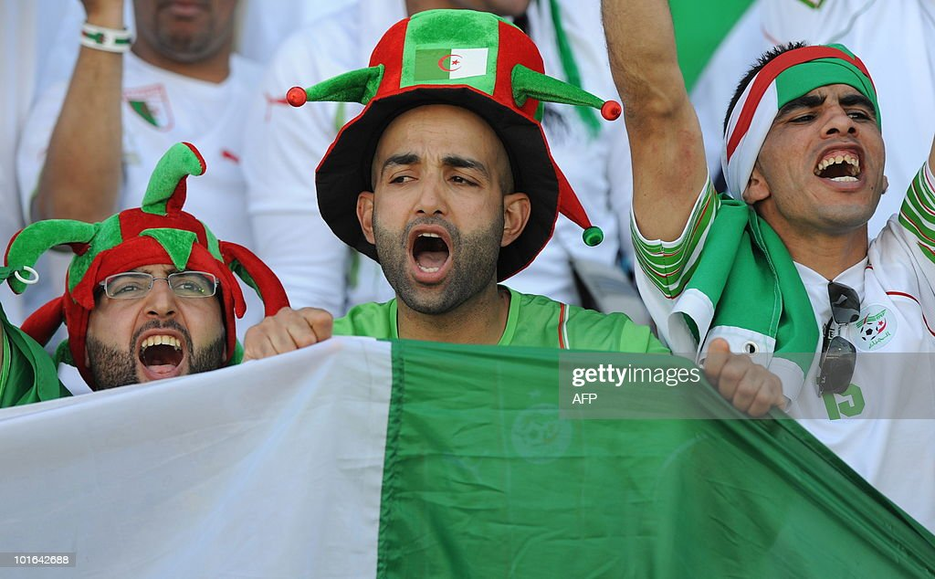 Supporters of Algeria cheer their team ahead of a friendly football match between Algeria and the United Arab Emirates in Fuerth, southern Germany, June 5, 2010.