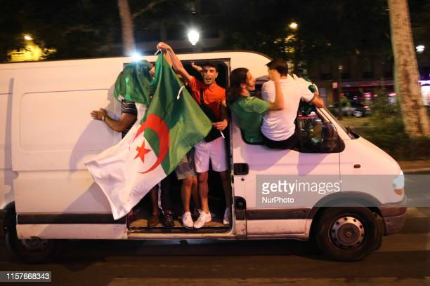 Supporters of Algeria football team celebrate after the victory in Africa Cup of Nations 2019 1/8 final match with Guinea in Paris France on 7 July...