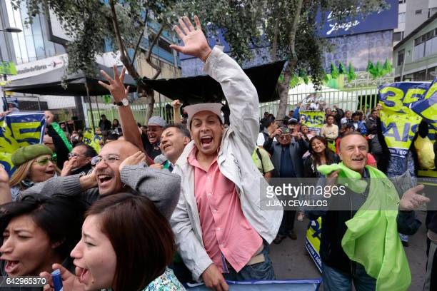 Supporters of Alianza Pais candidate Lenin Moreno celebrate at the headquarters of the party in Quito on February 19 2017 after knowing exit polls...