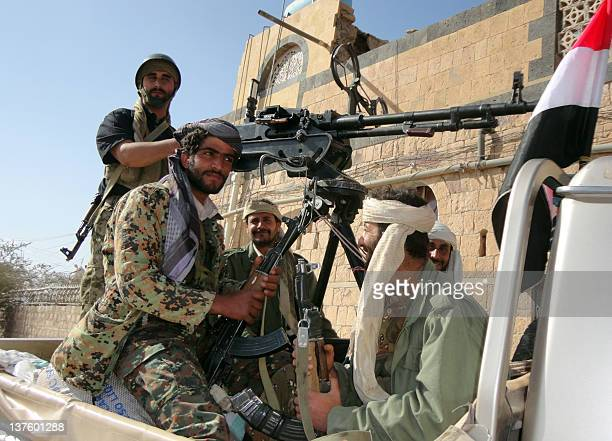 Supporters of alQaeda tote their rifles in the back of a pickup truck in the town of Rada 130 kilometres southeast of the capital Sanaa on January 23...