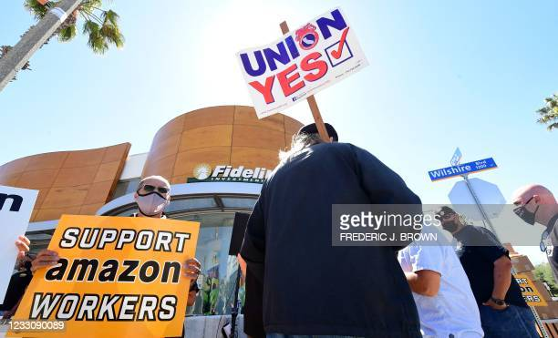 Supporters of Amazon workers protest in front of Fidelity Investments, one of the company's largest shareholders on May 24, 2021 in Santa Monica,...