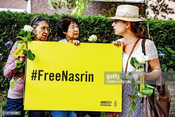 Supporters of Amnesty International campaign for the release of Iranian lawyer Nasrin Sotoudeh by celebrating a birthday party in front of the...