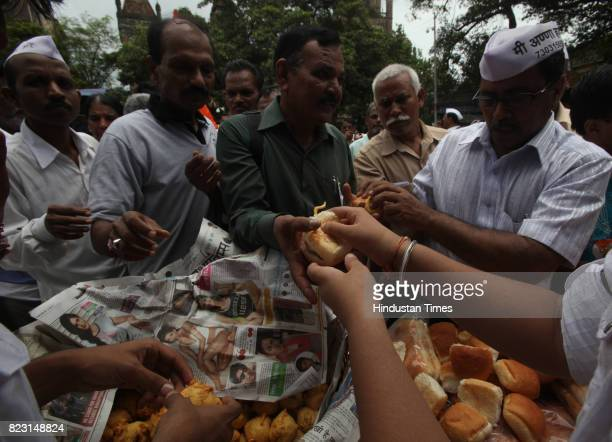Supporter's of Anna Hazare distributed free vada pav to the supporter who had come to protest at the Azad Maidan in Mumbai on Sunday