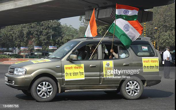 Supporters of Anna Hazare during a car and bike rally from Rajghat to Tughlakabad fort demanding a strong Lokpal bill in New Delhi India on December...