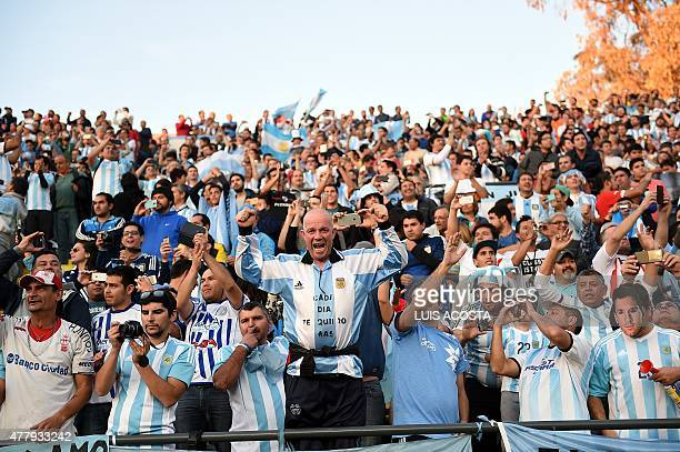 Supporters of Argentina cheer as they wait for the start of the 2015 Copa America football championship match between Argentina and Jamaica in Vina...