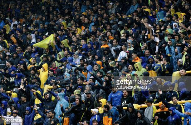 Supporters of Argentina's Boca Juniors cheer before the suspension of the Copa Libertadores 2018 first leg final football match between Argentinian...