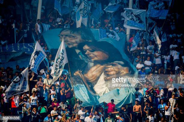 TOPSHOT Supporters of Argentina's former President and Buenos Aires senatorial candidate for the Unidad Ciudadana Party Cristina Fernandez de...