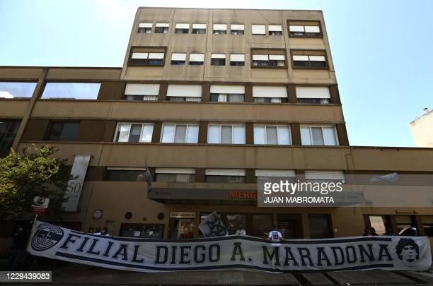 Supporters of Argentine former football star and coach of Gimnasia y Esgrima La Plata Diego Maradona, remain outside the Ipensa clinic where Maradona...