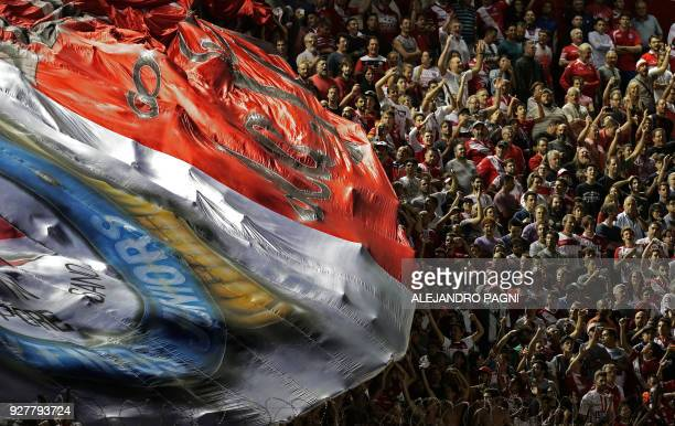 TOPSHOT Supporters of Argentinos Juniors cheer for their team during their Argentina First Division Superliga football match against Boca Juniors at...