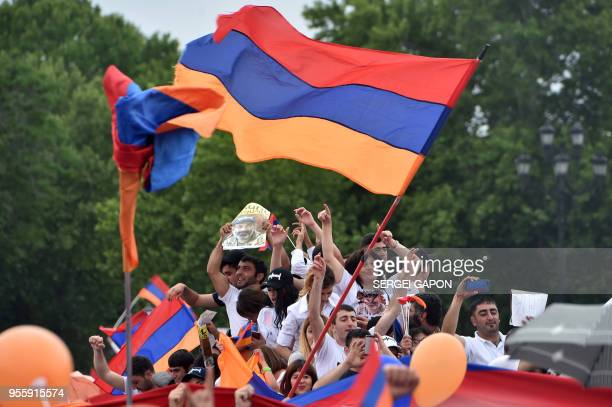 Supporters of Armenian opposition leader Nikol Pashinyan celebrate in Yerevan's Republic Square on May 8 2018 Armenia's parliament on May 8 2018...