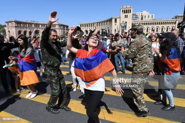 TOPSHOT Supporters of Armenian opposition leader Nikol Pashinyan dance at the central square of Yerevan on May 2 2018 Tens of thousands of Armenians...