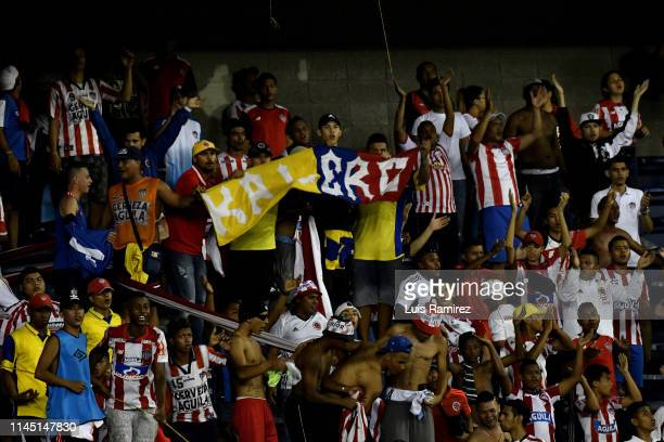 Supporters of Atletico Junior are seen with flags during a group F match between Atletico Junior and San Lorenzo as part of Copa CONMEBOL...