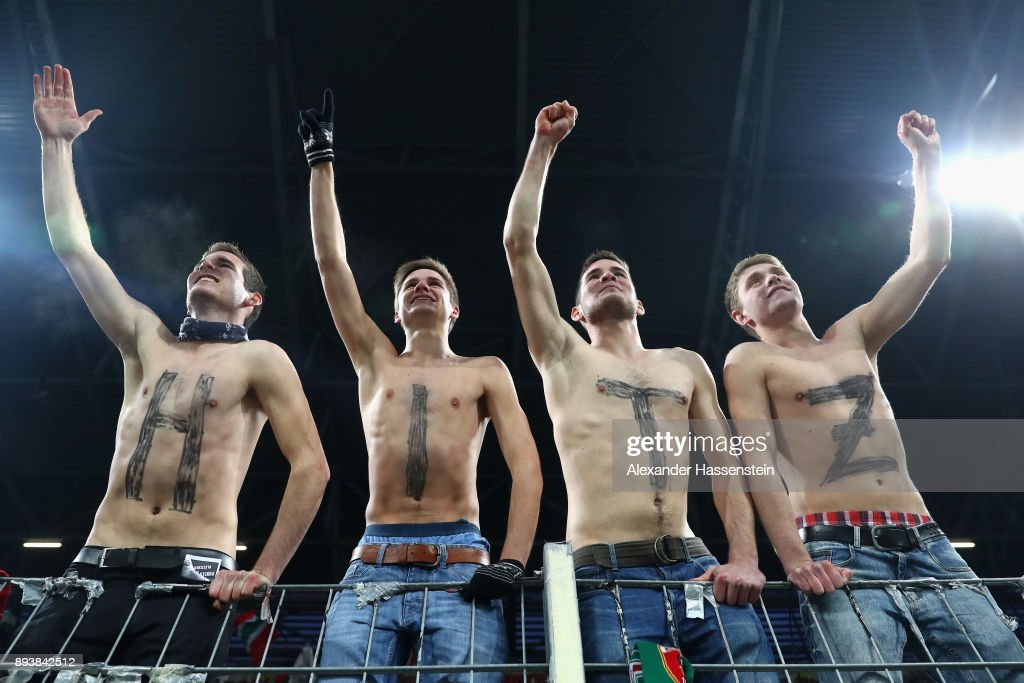 Supporters of Augsburg`s keeper Marwin Hitz celebrate during the Bundesliga match between FC Augsburg and Sport-Club Freiburg at WWK-Arena on December 16, 2017 in Augsburg, Germany.