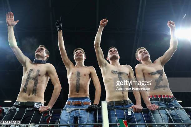 Supporters of Augsburg`s keeper Marwin Hitz celebrate during the Bundesliga match between FC Augsburg and SportClub Freiburg at WWKArena on December...