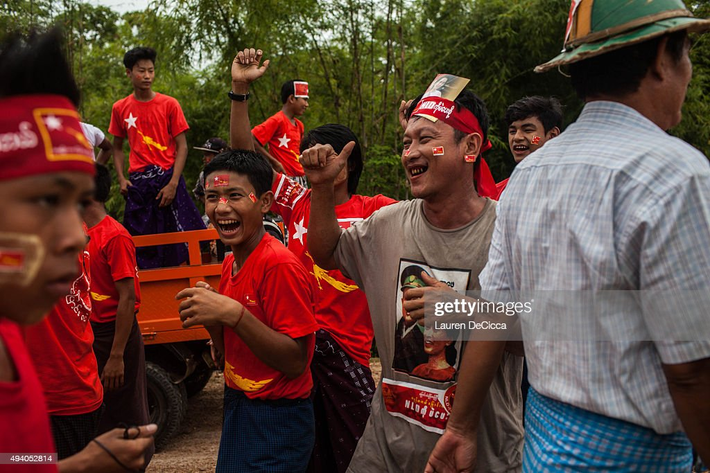 Supporters of Aung Sun Suu Kyi, leader of Myanmar's National League for Democracy Party, celebrate her arrival during her campaign period on October 24, 2015 in Kawhmu, Myanmar. Suu Kyi has been the parlimentary representative of Kawhmu since the 2012 bi-elections and has created new roads and a hospitality training school to increase prosperity in the constituency. Myanmar's elections are scheduled for November 8, 2015 and will be the fairest in the country's history.
