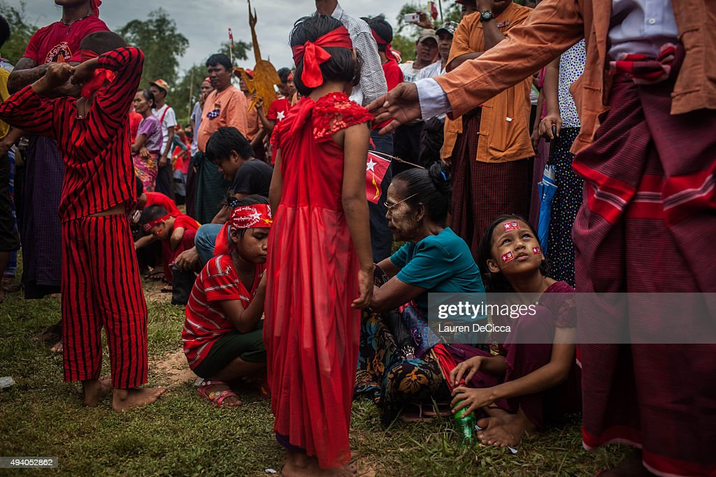 Supporters of Aung Sun Suu Kyi, leader of Myanmar's National League for Democracy Party, listen to her give a speech during her campaign period on October 24, 2015 in Kawhmu, Myanmar. Suu Kyi has been the parlimentary representative of Kawhmu since the 2012 bi-elections and has created new roads and a hospitality training school to increase prosperity in the constituency. Myanmar's elections are scheduled for November 8, 2015 and will be the fairest in the country's history.