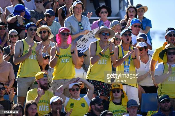 Supporters of Australia's Thanasi Kokkinakis cheer during his men's singles first round match against Russia's Daniil Medvedev on day two of the...