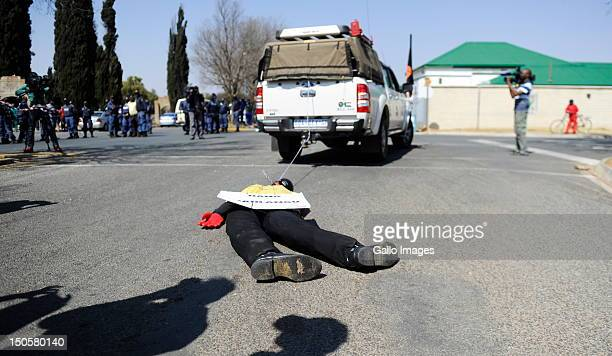 Supporters of AWB Leader Eugene Terre'blanche drag an effigy of Chris Mahlangu outside the courtroom as he and his coaccused Patrick Ndlovu appear in...