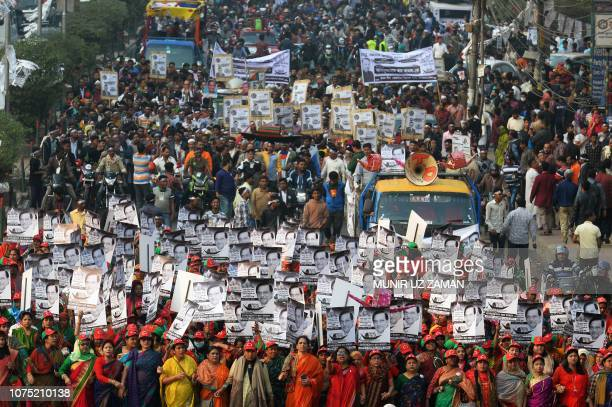 TOPSHOT Supporters of Bangladesh Awami League march along a street as they take part in a rally ahead of December 30 general election vote in Dhaka...