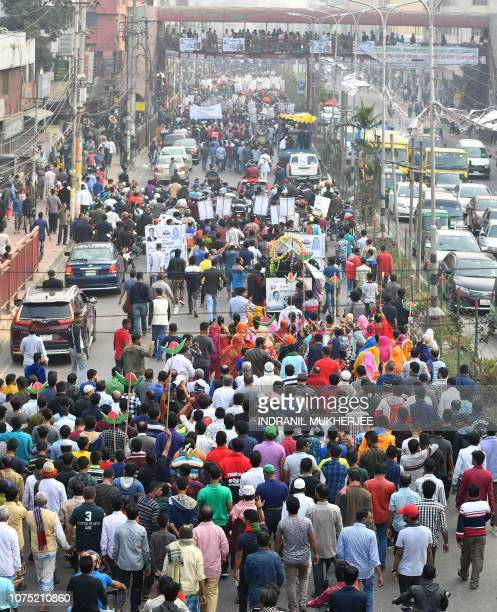 Supporters of Bangladesh Awami League march along a street during a rally ahead of the December 30 general election vote in Dhaka on December 27 2018...