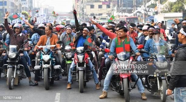 Supporters of Bangladesh Awami League shout slogans while taking part in a rally ahead of December 30 general election vote in Dhaka on December 27...