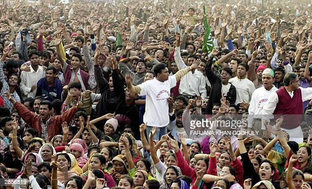 Supporters of Bangladesh's main oppsition party the Awami League shout in support of party leader Sheikh Hasina Wajed as she delivers her speech...