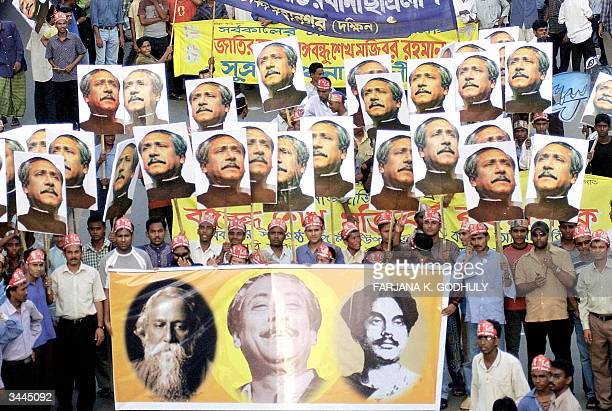 Supporters of Bangladesh's Opposition Leader Sheikh Hasima Wajed carry banners placardS and portraits of her father the country's founder Sheikh...