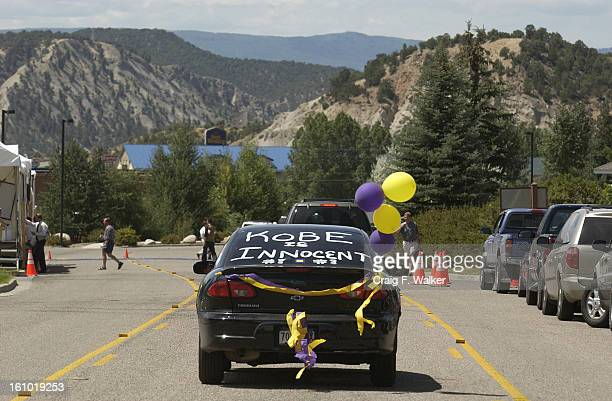 Supporters of basketball star Kobe <cq> Bryant <cq> pass the Eagle County Justice Center in Eagle CO on Wednesday August 6 2003 Bryant was to make...