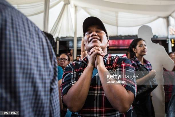 Supporters of Basuki Tjahaja Purnama prays after hearing the speech of basuki during the voting on February 15 2017 in Jakarta Indonesia Residents of...