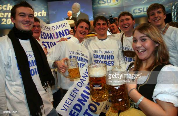 Supporters of Bavarian Governor Edmund Stoiber hold up posters during the traditional Christian Social Union Ash Wednesday rally on February 21 2007...