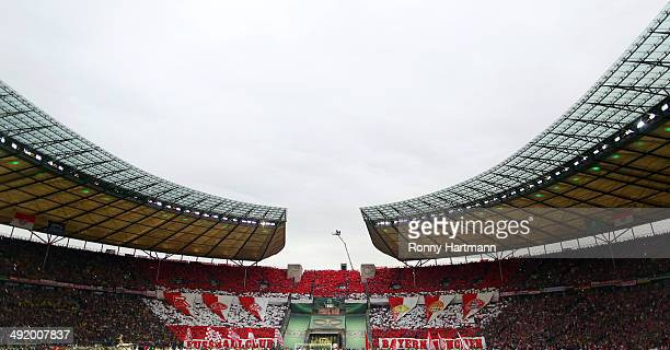 Supporters of Bayern Muenchen cheer during the DFB Cup final match 2014 between Borussia Dortmund and Bayern Muenchen at Olympiastadion on May 17,...