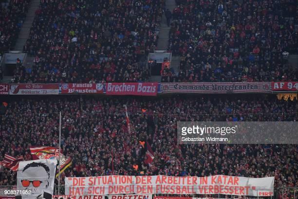 Supporters of Bayern Muenchen show a banner with the wording 'Die Situation der Arbeiter in Katar hat dich durch den Fussball verbessert' during the...