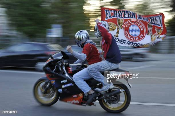 DFL Supporters of Bayern Munich wave the flag of their club as they ride through the streets of Munich after the Wolfsburg vs Munich Bundesliga...