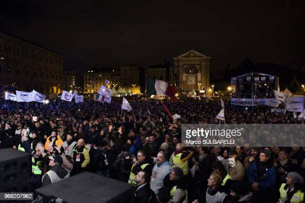 Supporters of Beppe Grillo and Five Star Movement in Piazza San Giovanni during Beppe Grillo last political rally before the national election on...