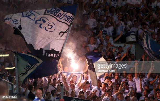 Supporters of Berlin celebrate their team during the DFB Cup first round match between FC Hansa Rostock and Hertha BSC at Ostseestadion on August 14...
