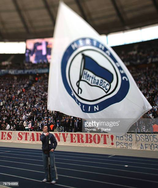 Supporters of Berlin cheer their team prior to the Bundesliga match between Hertha BSC Berlin and Arminia Bielefeld at the Olympic stadium on...